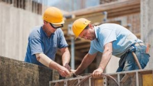 two construction workers on a worksite