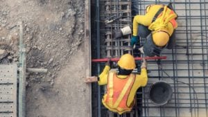 construction workers work on a concrete floor