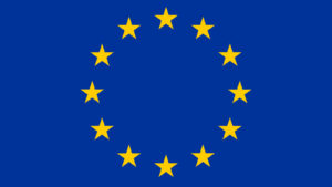 the European Union flag, a circle of gold stars on a navy blue background