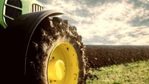 a tractor tire pictured in a field on the tractor