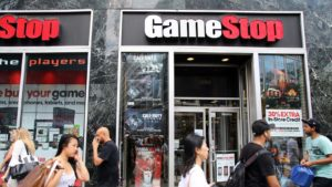 Retailers walk past a GameStop (GME stock) store in New York City, New York.