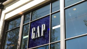 A close-up view of a Gap (GPS) sign in the window of a Los Angeles, California mall.