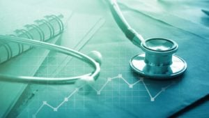 stethoscope on a stock chart representing healthcare stocks to buy