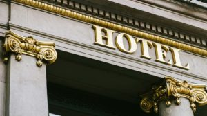 AHT stock: the front of a hotel with ornate columns