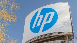 HP (HPQ) sign with blue sky and autumn leaves as backdrop