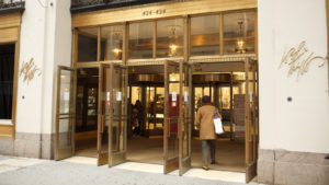 Image of a Lord & Taylor storefront with a person entering the doors