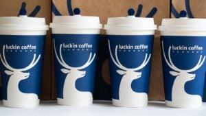 Four Luckin Coffee (LK) coffee cups are arranged in a row.