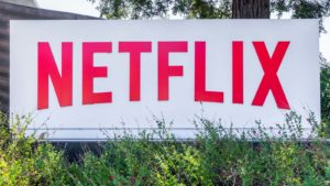 the netflix (NFLX) logo displayed on a sign outside