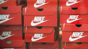 a stack of red Nike (NKE) shoe boxes