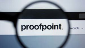 the proofpoint (PFPT) logo displayed on a web browser magnified through the lens of a magnifying glass