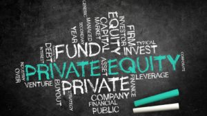A word cloud of private equity concepts is written on a chalkboard.