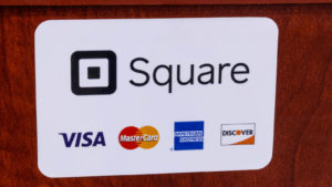 A photo showing payments that are accepted at a store, including Square (SQ).