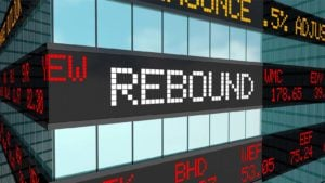 """The word """"rebound"""" flashes on a stock market ticker board."""
