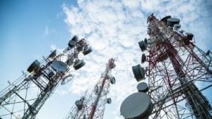 a picture of cell towers during daytime