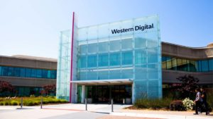 photo of glass Western Digital (WDC) company building with black letter logo on front face
