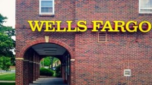 A Wells Fargo (WFC) sign hangs on a brick building in Bloomfield, Connecticut.