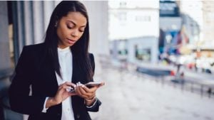 Image of a black woman on her smartphone.