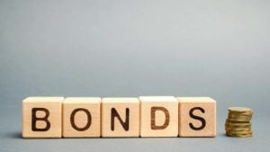 Wooden blocks with the word Bonds and coins.