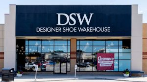 a the storefront of a DSW shoe store