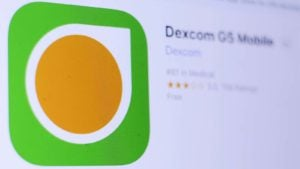 Dexcom (DXCM) logo on an app store page on a mobile phone