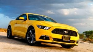 a yellow ford (F) mustang representing cheap stocks