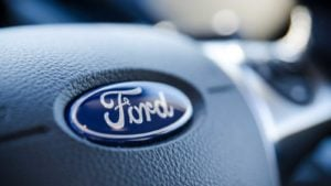 Ford (F) logo on a steering wheel