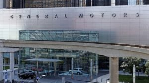 General Motors (GM) spelled out on front of silver-colored building