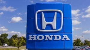 honda logo on a sign outside a honda dealership