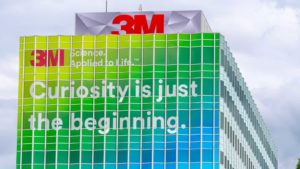 3M (MMM) building with logo and words on the side reading