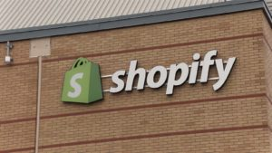shopify logo sign on building facade