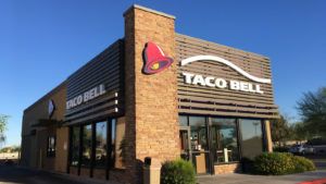 The close-up of a Taco Bell (YUM) store with logo on the front.