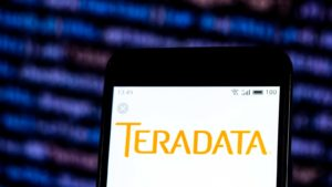 mobile phone screen displaying teradata (TDC) logo, representing cheap stocks to buy