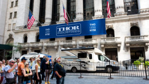 A blue Thor Industries (THO) banner hangs outside the New York Stock Exchange.