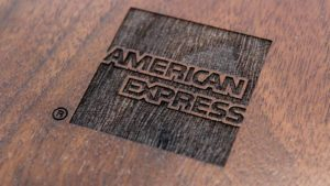 the American Express logo etched into wood