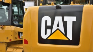Image of a yellow construction vehicle with the Caterpillar (CAT) logo on it