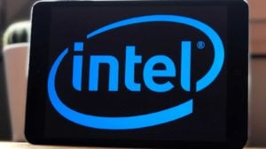 The Intel (INTC) logo in blue on a black screen. it represents blue-chip stocks