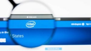 a magnifying glass enlarges the Intel logo on the company website