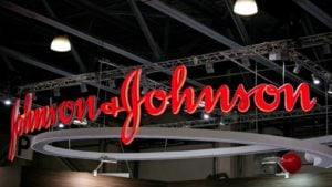 A red Johnson & Johnson (JNJ) sign hangs inside in Moscow, Russia.