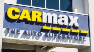 a Carmax (KMX) sign on a storefront