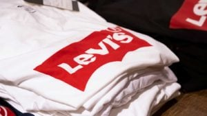 a stack of white t-shirts with the Levi's (LEVI) logo on them