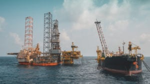 oil rigs on water, representing high-risk stocks like RIG
