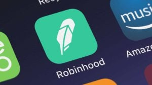 Robinhood's mobile app logo is displayed on a smartphone screen. Robinhood stocks
