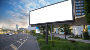 an empty billboard on a highway