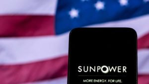 a phone with the sunpower logo in front of a U.S. flag