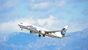 Alaska Airlines (ALK) aircraft is airborne as it departs Los Angeles International Airport