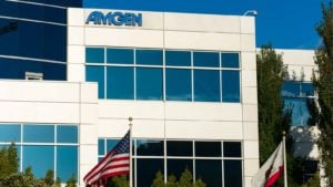 the Amgen (AMGN) logo on a building during daylight