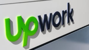 upwork (UPWK) logo on a building