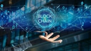 futuristic image of a hand with the words block chain floating above it. representing blockchain stocks