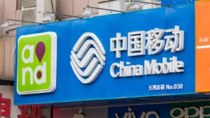 A banner outside a China Mobile (CHL) store in Beijing, China.