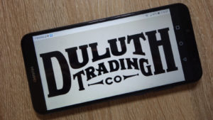 a smartphone with the Duluth Trading Co logo displayed onscreen